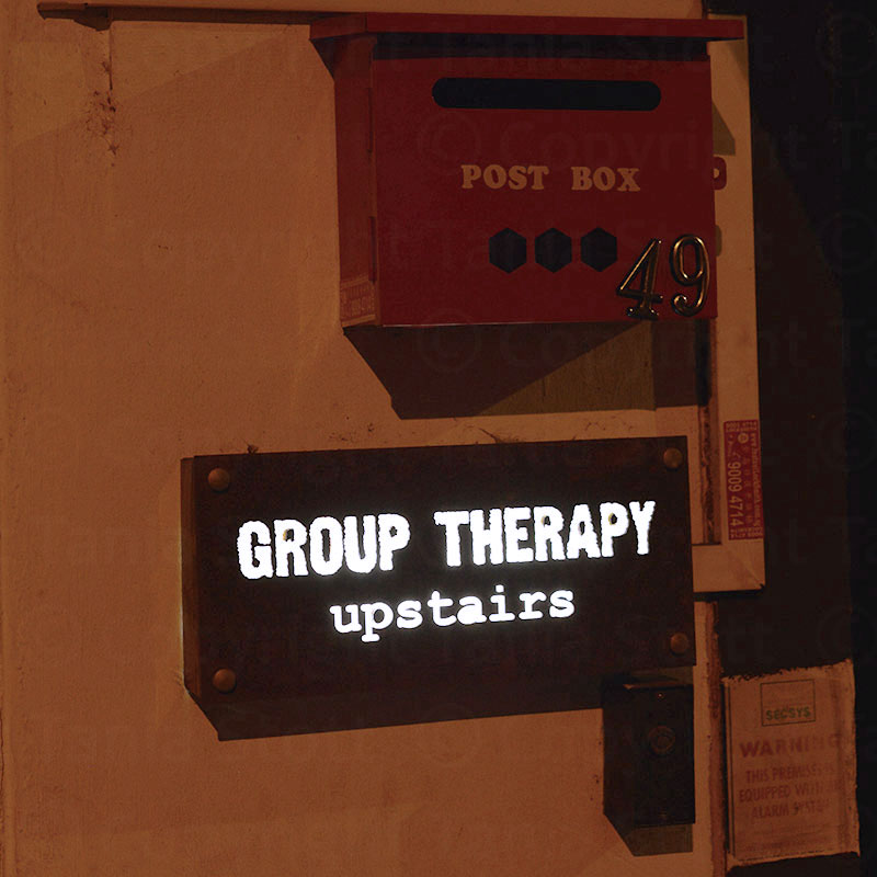 Singapore group therapy sign next to door
