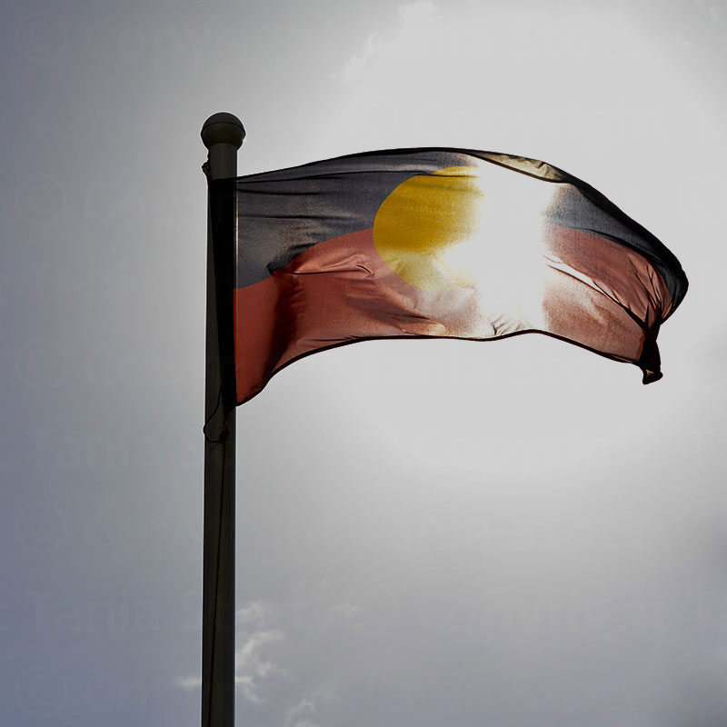 Aboriginal flag lit by the sun